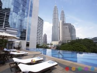 Centrally situated in the capital of Kuala Lumpur, Impiana KLCC Hotel features free high-speed internet access, an outdoor pool, award-winning spa and 4 dining options. Certain rooms offer 5-star club services.  Rooms at this Kuala Lumpur hotel offer a pillow menu, free newspaper and 24-hour room service. Each room has satellite TV, tea/coffee maker, minibar and safe.