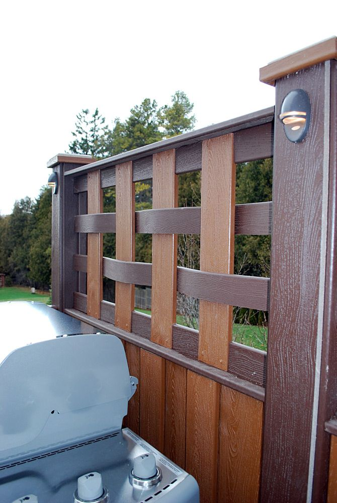A custom curved woven privacy screen from decked out for Creative privacy screen ideas