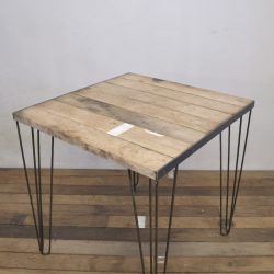 Small, square handcrafted industrial table, reclaimed wood top and metal hairpin legs. Loft style. Retro design. Restaurant table.