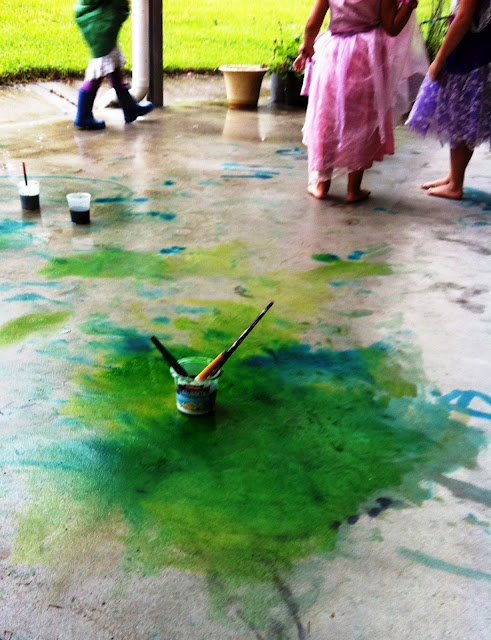 Painting in puddles...what a fun way to experience the arts in weather!