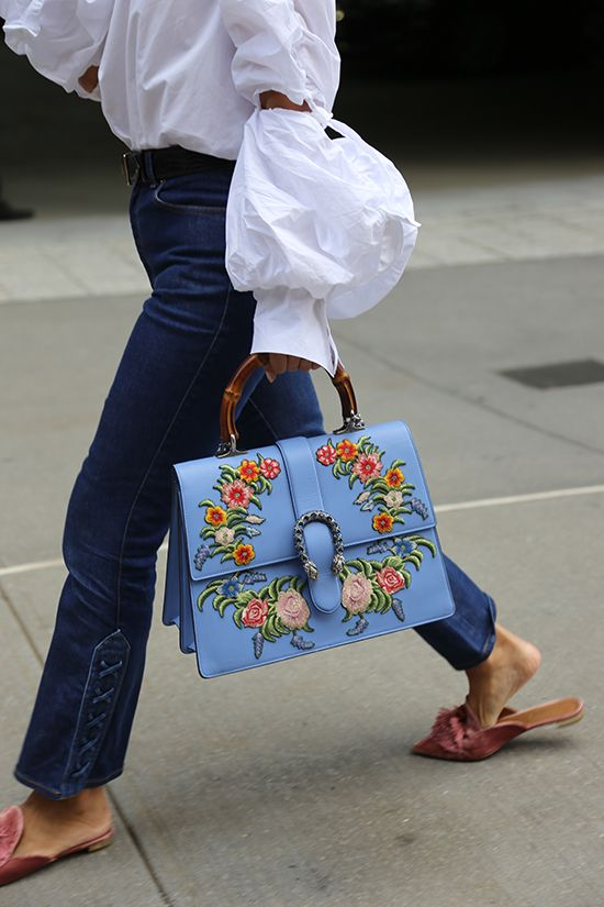 Want a fast way to update your entire wardrobe? Pick up one of the handbags the Fashion Week cohort is carrying this season, like this Gucci Dionysus bag.