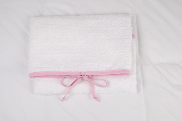 Change mat covers to tie on and cover the cold plastic / pvc inners. The ties make sure the mats dont slip off and these are available in white toweling with trim and ties in blue, pink, red, white, navy, stone and grey. http://www.tomandbella.co.za/pN111/Change-mat-cover.aspx
