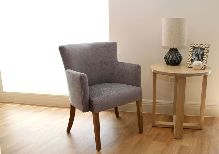 We love the velvet finish on this beautiful Belinda timber armchair. The light finish on the side table works well with the grey tones.