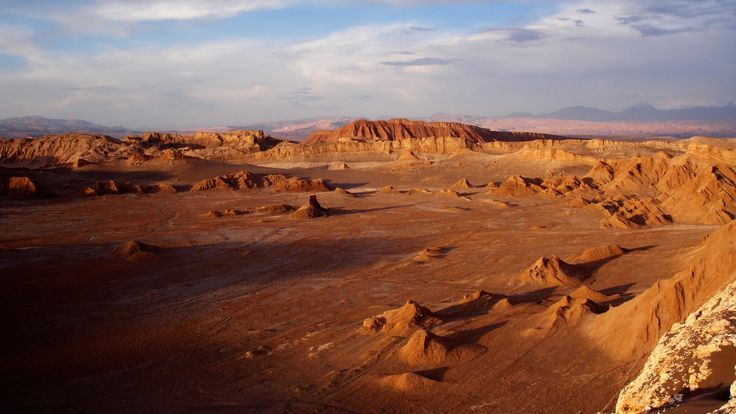 Atacama Desert South America (Chile) - The driest place on earth.  Some parts haven't seen ANY rain since recordkeeping began.  More than one million live there.
