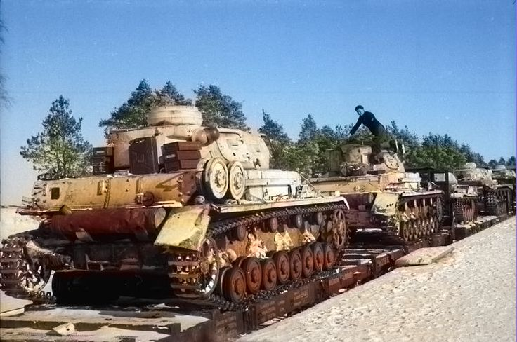 Colorized photos of Panzer II, III, IV's on flatcars on the Eastern Front, 1943