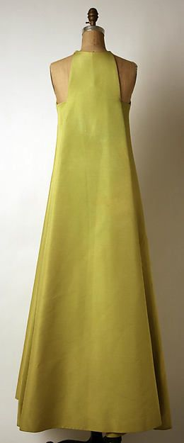 Evening dress - 1960s celery green wool blend gown, by French designer Madam Gres.  High neck with squared cut-away sleeveless treatment.  A-line structure