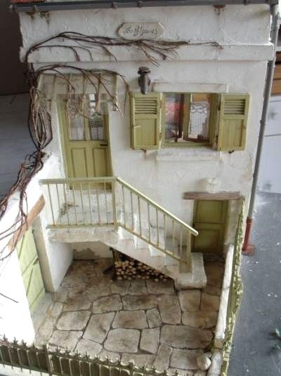 Did I pin this before?  I love dollhouses with yards or patios - this Dollhouse is so quant... Not so traditional ... I Like...