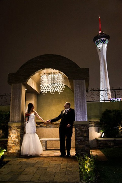 one of our iconic chapel of the flowers photos with the stratosphere in the background
