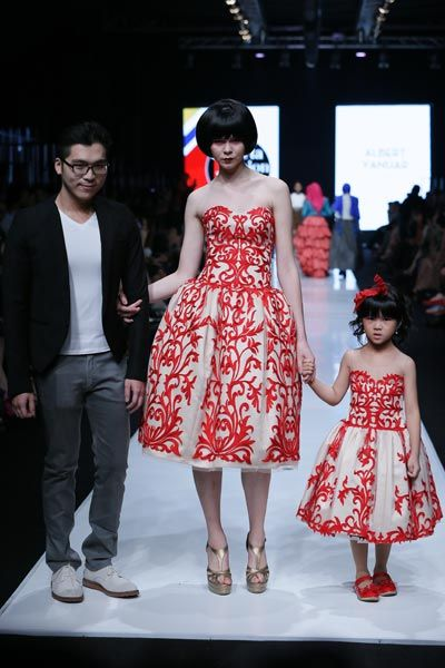 fig.: Designer Albert Yanuar and items from the new collection 'Morfogene' Spring/Summer 2014 on the runway of Indonesia Fashion Forward during Jakarta Fashion Week 2014 at Senayan City on 19 October 2013 in Jakarta. Photo by Irvan Arryawan/Feminagroup.