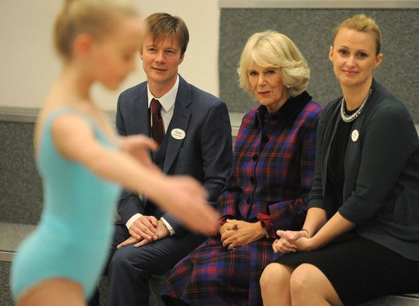 Camilla, Duchess of Cornwall watches students perform with Artistc Director Robert Parker (left) and Principal Jessica Wheeler during a tour of Elmhurst School of Dance on November 25, 2014