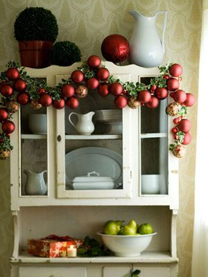 simple and traditional.....red baubles on a garland....