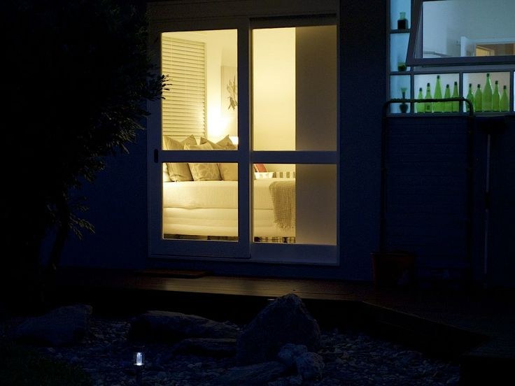 window at night from outside looking at bedroom 2 from outside at