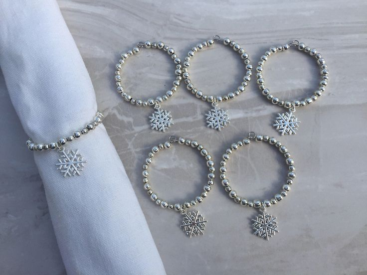 A personal favourite from my Etsy shop https://www.etsy.com/uk/listing/256149179/silver-snowflake-christmas-napkin-rings