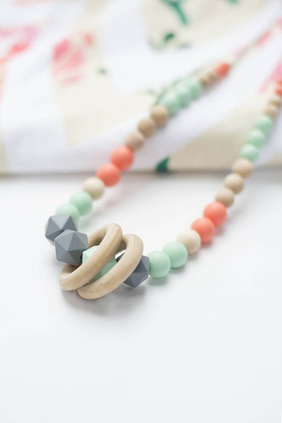 My Sunshine Studio offers Handcrafted Nursing Necklaces for the Modern Mom. This nursing necklace offers a modern spin on beautiful accessories and offers our fullest strands yet. With soft, on-trend colors, this teething necklace for mom is a beautiful addition to any wardrobe. Silicone, and raw unfinished wood beads make this necklace both subtle and on-trend. The fact that it's a teething necklace is an added bonus! All My Sunshine Studio teething necklaces are made of raw, unfinished…