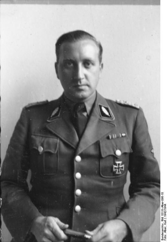 Helmut Knochen was the senior commander of the Sicherheitspolizei (Security Police) and Sicherheitsdienst (SD) in Paris during the Nazi occupation of France. Although responsible for war crimes, he evaded the death sentence twice and was reprieved in 1963. He died a free man in Germany in 2003.