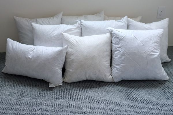 Buy ugly on sale pillows and remove the covers to get your own pillow forms. Why haven't I thought of this??