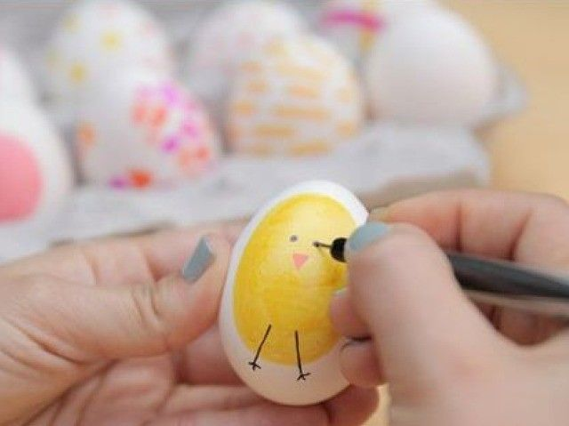 Painting and decorating the shells of eggs for Easter