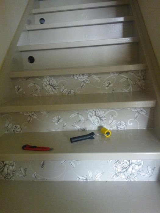Decorating a stairway with some wall paper. Don't forget to put on a couple of layers varnish to keep it in great shape