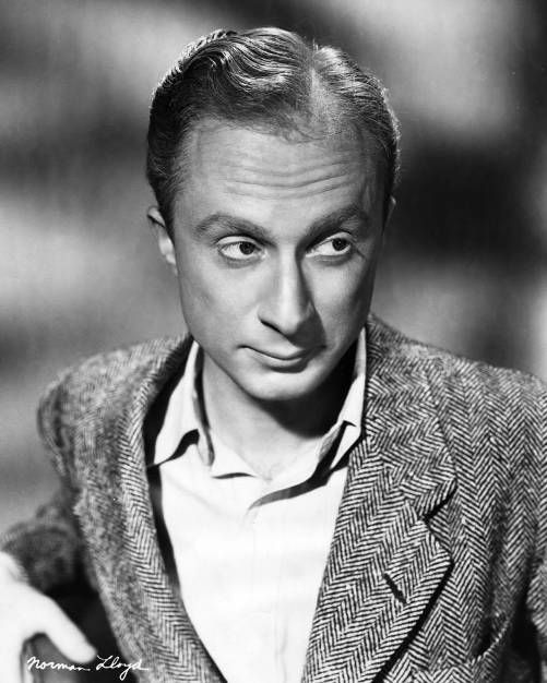 """Norman Lloyd, as an actor with a long career. At this young age, he was the guy hanging off the Statue of Liberty in the Hitchcock film """"Saboteur""""."""