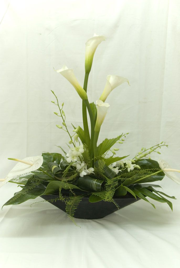 White and green centerpiece www.tablescapesbydesign.com https://www.facebook.com/pages/Tablescapes-By-Design/129811416695