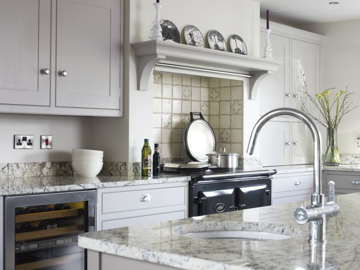 Beautifully crafted bespoke painted kitchen. Worktops Crema Antardia Granite, Tiles Fired Earth (clients own), Aga in Pewter, cabinets & mantle shelf in Farrow & Ball Dovetail, island (just seen) Farrow & Ball Charleston Grey, walls Farrow & Ball Skimming Stone.