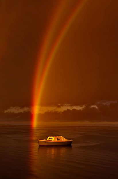 An amateur photographer was stunned when he captured rare meteorological phenomenon - a reflection rainbow. Phil Thompson was walking along a jetty at the Bellarine Peninsula in Victoria, Australia, when he spotted a rainbow reflecting off the sea to create two visible arcs of colour emanating from the same spot. Reflection rainbows occur when sunlight is first deflected by the raindrops, and then reflected off a body of water.