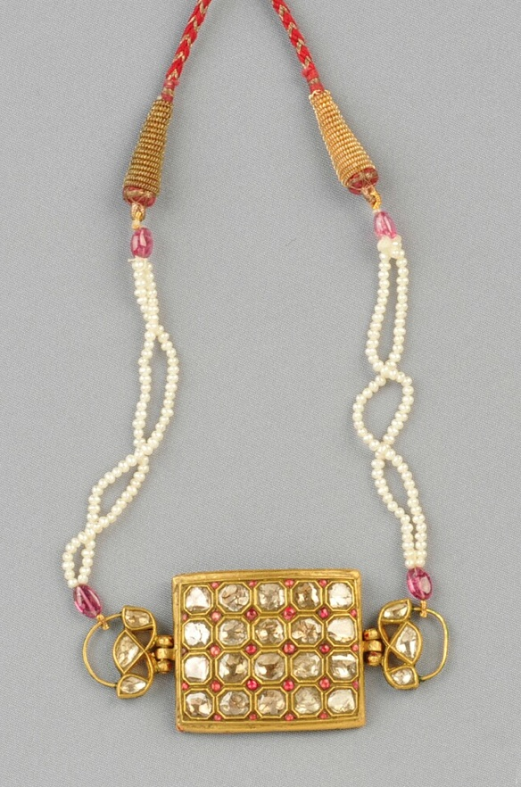 18kt Gold, Enamel, Diamond, and Seed Pearl Necklace, India, the central plaque set with rose-cut diamonds, red enamel accents, reverse with various colored enamels, joined by a double strand of seed pearls with pink tourmaline bead accents, completed by a woven cord, lg. to 33 in.