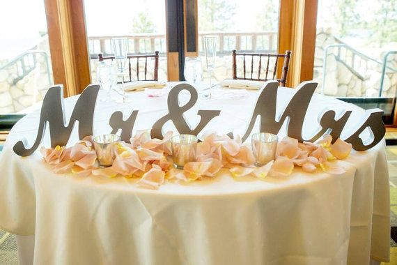 Love this! Etsy listing at https://www.etsy.com/listing/205110785/silver-mr-and-mrs-wedding-signs-for