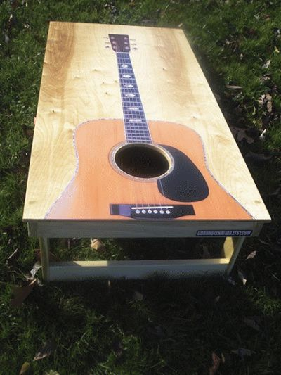Guitar Cornhole Board Design...I was thinking a coffee table like this for your living room!