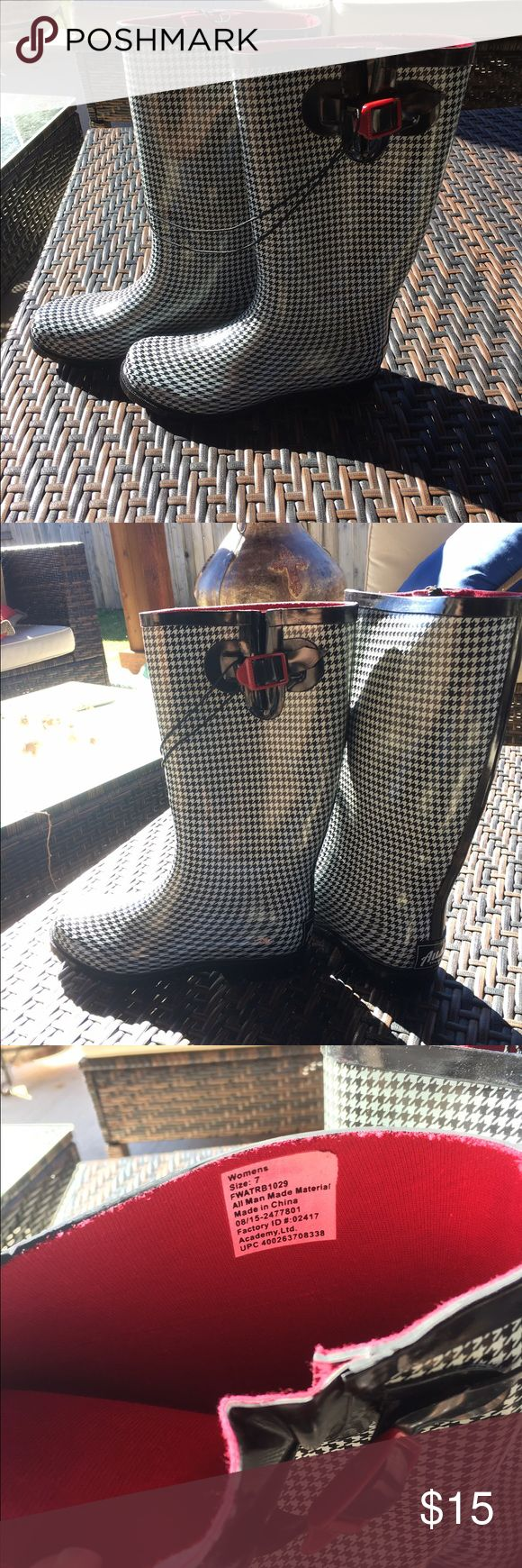 NWT Black and White Rain Boots Size 7 NWT Size 7 from Academy, Austin brand rain boots. Black and white houndstooth print with red felt interior lining. Red accent buckle. Austin Shoes Winter & Rain Boots