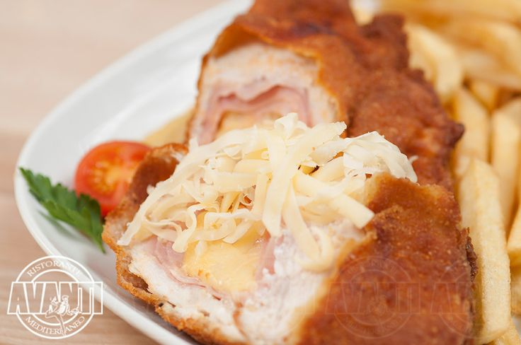 Chicken Cordon Bleu (Chicken breasts filled with cheese and ham, with French fires)