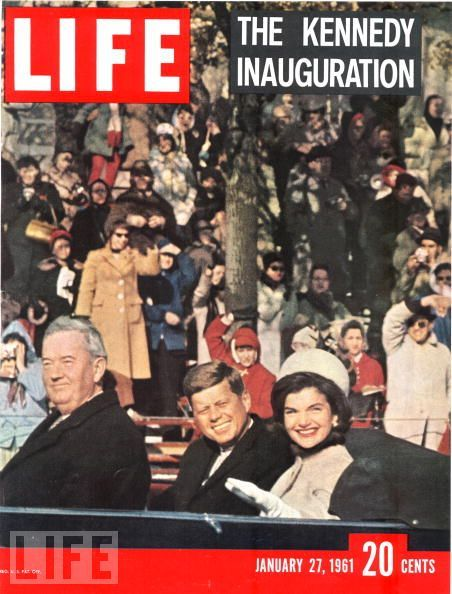 "JFK and Jackie ride to the White House after the inauguration. ""Ask not what your country can do for you,"" he famously said in his address. ""Ask what you can do for your country."""