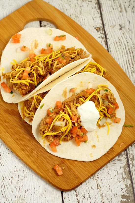 Easy but flavorful Crockpot Chicken Tacos recipe is a true fix-it-and-forget meal, with just 5 ingredients. Top these zesty chicken tacos with cheese, sour cream, and pico de gallo for a full family slow cooker meal! Love this! So easy!