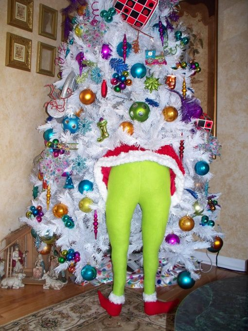 Stuff green tights with pillow stuffing and shove him in your tree.    So want to do this!  hahahaha!