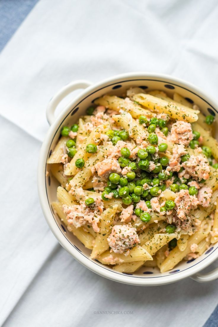 Delicious penne with salmon, green peas and cream sauce for cooler summer days