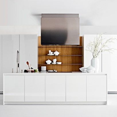 Modern white kitchen with hidden wooden storage concealed behind  white cupboard doors. Interior design ideas and inspiration from HOUSE by House & Garden.