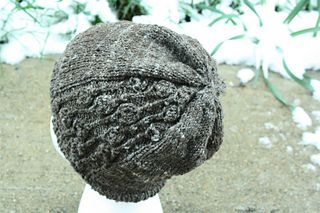 A cozy, lightweight hat for when Spring starts hinting it has arrived, this hat is a slightly slouchy beanie with a section that looks like flower buds. Originally knit to show off some beautiful sportweight handspun - a CVM wool/yak blend by Herie7 - it would look equally lovely in a fuzzy sportweight or DK yarn.