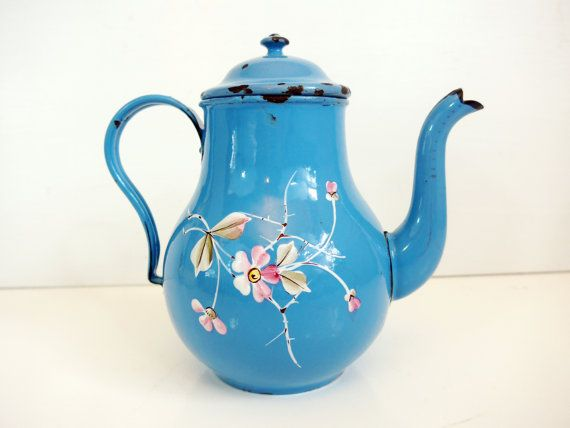 Such a sweet little coffee pot with real enamel decoration that is most likely French and from the early part of the 20th century.There are