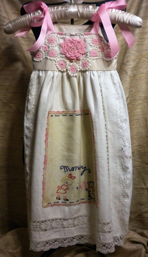 Wonderful child's sundress!  Easy project made from vintage lace-edged pillow case, with embroidered inset (dresser scarf) . Half doily sewn on bodice, ribbon ties.