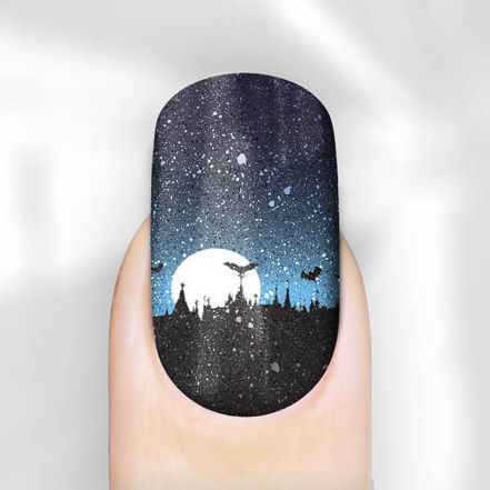 Rebel Nails take it one step further and give you entire SCENES, literally at your fingertips. Silver glitter with little skulls, sparkly scenes of moons, castles and bats, witches flying over haunted houses on broomsticks -- it's all enough to make your inner goth do a happy jig.
