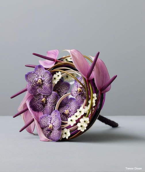 Modern spiral bridal bouquet, with lilac spotted vanda orchids and anthurium.