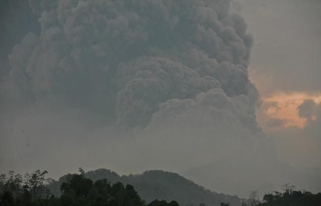 Mount Kelud erups, as seen from Mbalak village in Blitar East Java, Indonesia, Friday, Feb. 14, 2014. Volcanic ash from a major eruption in ...