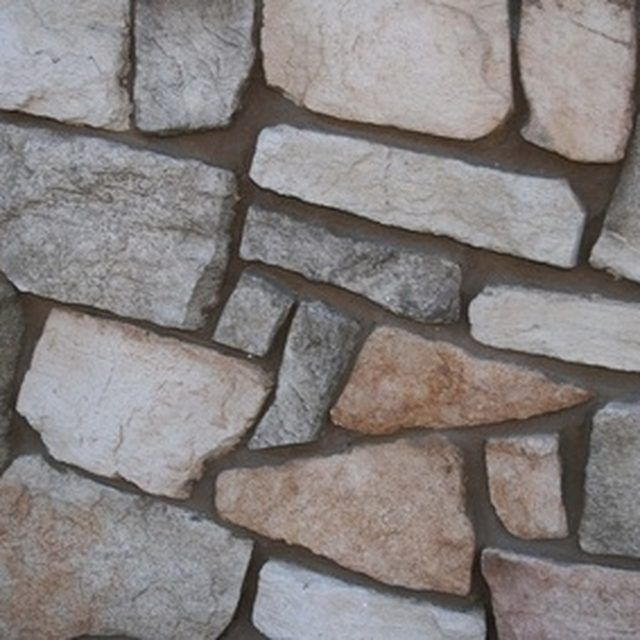 Design and build a rock wall with fake rocks.