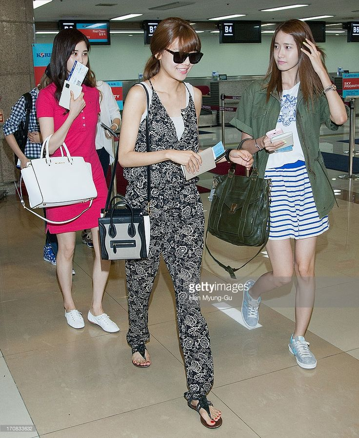 Sooyoung and Yoona of South Korean girl group Girls' Generation are seen on departure at Gimpo International Airport on June 19, 2013 in Seoul, South Korea.