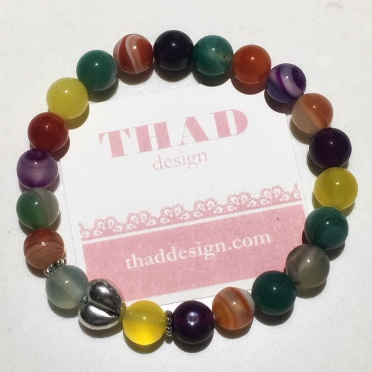 Colourful stretch bracelet made of Agate stone beads and a silver plated heart.  Add some color -and love - to your day! ❤️💛💚💙💜🖤   #bracelet #armcandy #thaddesign