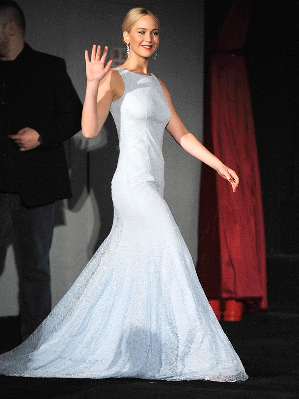 The 25-year-old paired her lace-and-silk pale blue gown with sparkling chandelier earrings and a deep raspberry lip at the The Hunger Games: Mockingjay – Part 2 premiere in Beijing, China, on Thursday evening.