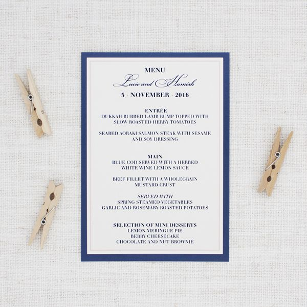 This classic navy blue and blush pink wedding menu is charming and traditional. It is a perfect way to present your wedding menu.