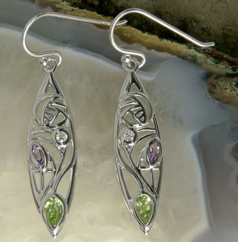"Sterling silver Charles Rennie Mackintosh ""Sauchie"" diamond, amethyst & peridot earrings. Click here: http://rennie-mackintosh-jewellery.co.uk/earrings/rennie-mackintosh-sterling-silver-earrings-sauchie-amethyst-peridot-diamond-341/ #charles #rennie #mackintosh #silver #earrings #diamond"