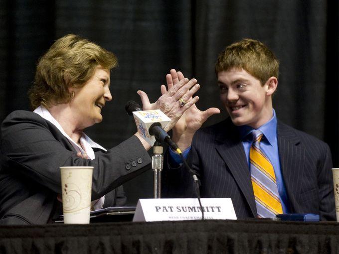 Pat Summitt and her son, Tyler Summitt, clasp hands