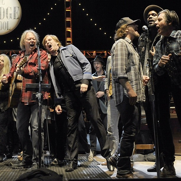 """#NeilYoung wrapped the 26th Annual #BridgeSchoolBenefit Saturday night with an all-star jam of """"Rockin' in the Free World"""" joined by #EddieVedder, #JohnDoe, Jack White and #GaryClarkJr. Read the full recap at RollingStone.com Photo: Tim Mosenfelder/Getty Images"""